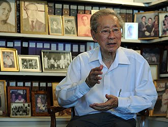 Dr Lim at home, surrounded by family photos. He met his wife, who is a kidney specialist, when they were working together at SGH. Their son was only five months old when Dr Lim was detained in 1963. -- ST PHOTO: AZIZ HUSSIN